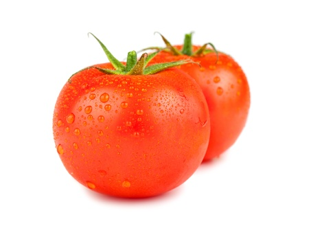 Two ripe red tomatoes with water drops isolated on white background Stock Photo - 21462242