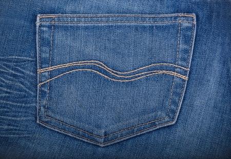 jeans pocket: Empty back pocket of blue jeans. Denim texture background. Stock Photo