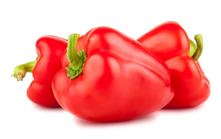 Three red sweet peppers isolated on white background