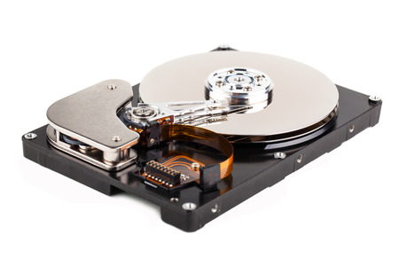 Opened computer hard drive isolated on white background Stock Photo - 22927012