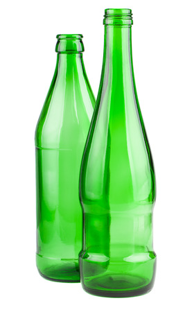 Two empty green bottles isolated on a white background photo