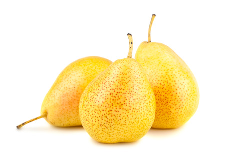Three ripe yellow pears isolated on white background photo