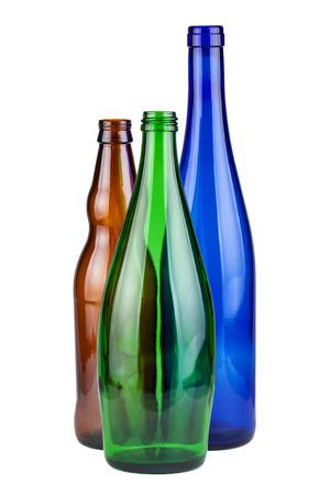 Three empty bottles isolated on white  photo
