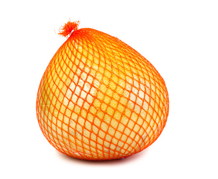 Wrapped in plastic reticle ripe pomelo isolated on white  photo