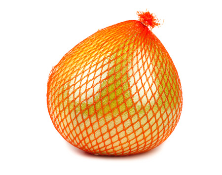 citrus maxima: Wrapped in plastic reticle ripe pomelo isolated on white  Stock Photo
