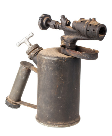 kerosene lamp: Vintage old blowtorch isolated on white background Stock Photo