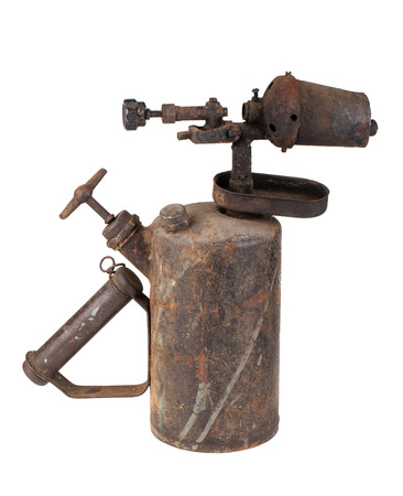 Vintage rusty blowtorch isolated on white background photo