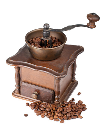 Vintage coffee grinder with coffee isolated on white background photo
