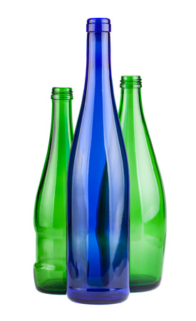 Green and blue empty bottles isolated on white background photo