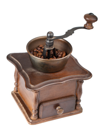 Vintage coffee mill isolated on white background photo
