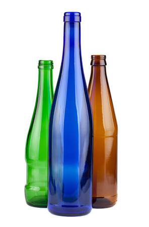 Brown, green and blue empty bottles isolated on white background photo