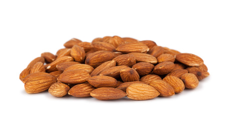 Heap of almond nuts isolated on white background Stock Photo