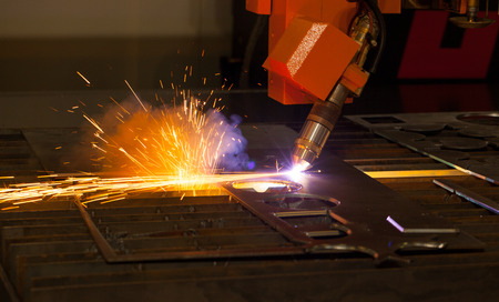 Industrial plasma cutting machine with sparks photo