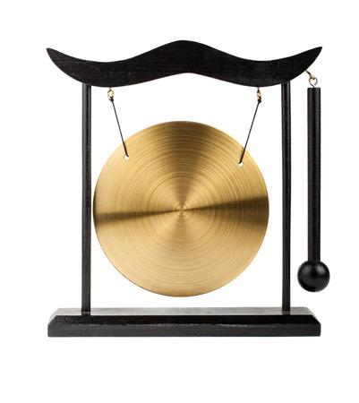 Decorative bronze gong isolated on white background photo