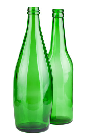 Two green empty bottles isolated on white background photo