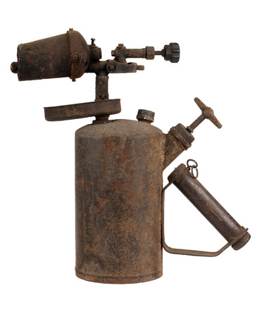 Old rusty blowtorch isolated on white background photo