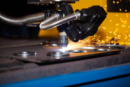 Industrial cnc plasma cutting machine with sparks Stock Photo