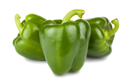 Three sweet green peppers isolated on white background