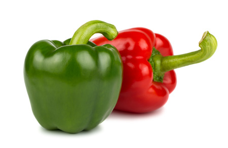 Green and red sweet peppers isolated on white background