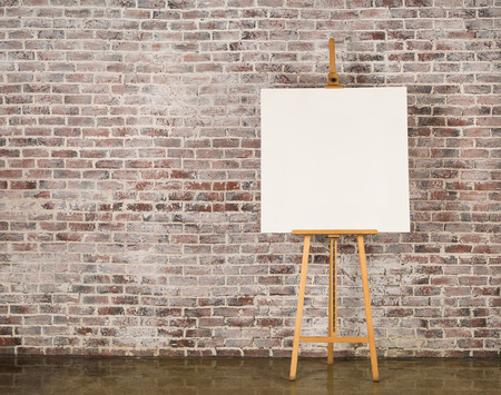 canvas texture: Easel with blank canvas on a brick wall background Stock Photo