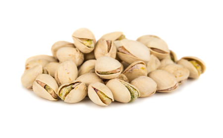 pistachios: Heap of salted pistachio isolated on white background Stock Photo