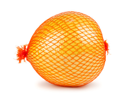 reticle: The pomelo fruit wrapped in plastic reticle isolated on a white background
