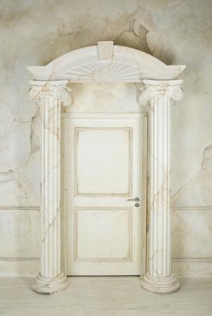 white door: Classic interior with columns and closed door Stock Photo