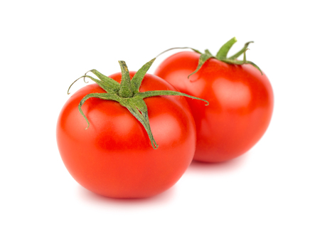 Two red ripe tomato isolated on white background