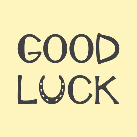 good luck charm: Grey colored lettering good luck with horseshoe as letter u isolated on flaxen background. Design element