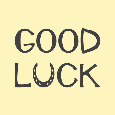 buena suerte: Gris coloreado letras buena suerte con la herradura como letra u aislado en el fondo de lino. Elemento de diseño