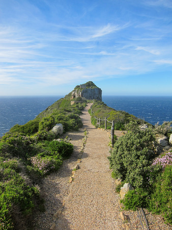 foot path: Cape point at Cape of Good Hope, where the Indian and Atlatic oceans meet. Foot path towards the lands end. Stock Photo