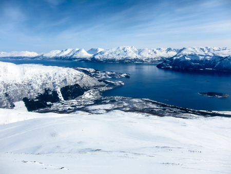 polar climate: Panorama of winter mountains and fjords from a peak in the Lyngen Alps, Lyngseidet, Norway