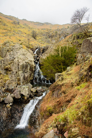 langdale: Mountain waterfalls in early spring. Stickle Ghyll, Lake District, England. Stock Photo