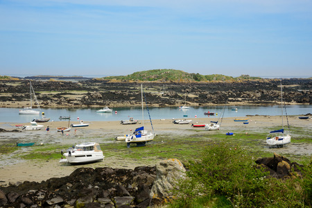 Low tide stranded boats in the archipelago of Iles de Chausey, Brittany, France (1)