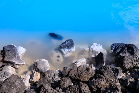 Closeup of stones in the famous blue lagoon near reykjavik iceland