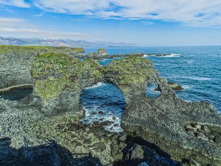 Volcanic stone rock gatklettur at the beach at arnarstapi iceland on the snaefellsnes peninsula