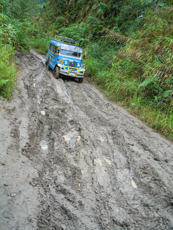 Traditional blue jeepney in the jungle of the philippines Stock Photo