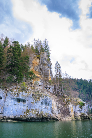Rock like a face near saut du doubs waterfall in the region of doubs switzerland