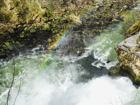 Rainbow over saut du doubs waterfall in the region of doubs switzerland