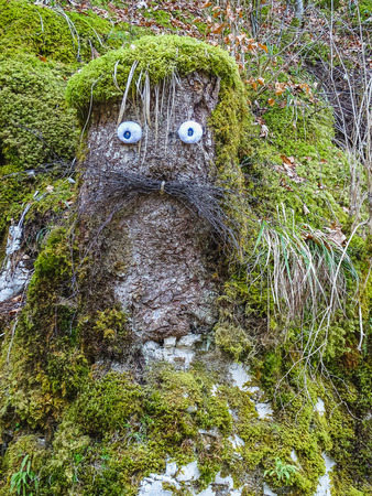 crazy wooden statue near saut du doubs waterfall in the region of doubs switzerland