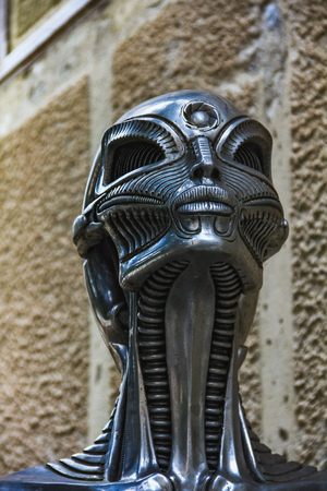 statue of HR Giger cafe with his biomechanical style in Gruyeres