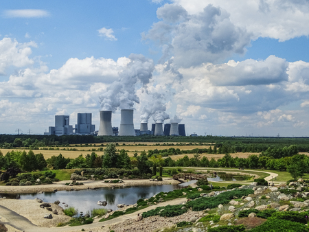 view to coal power plant boxberg from findlingspark nochten in germany