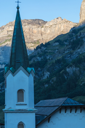 Amazing landscape of the Gemmi cliff, church in foreground in Switzerland, Europe