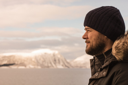 bearded man on a cold day outdoor in winter clothes in norway Stock Photo