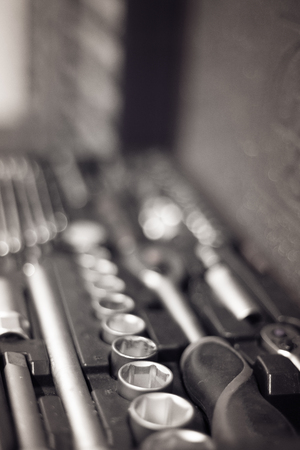 monochrome closeup of a toolkit case with full equipment, garage