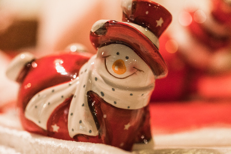 close up of a snowman figure in a santa claus costume, xmas