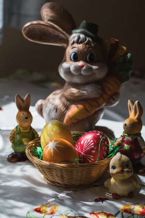 Traditional easter decoration with colorful eggs, rabbit and chicken on a table Reklamní fotografie