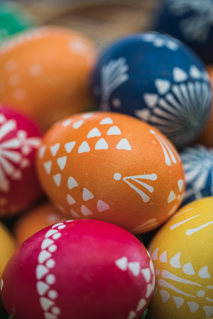 Detailed macro shot of handpainted colorful easter eggs in a decorative nest, germany