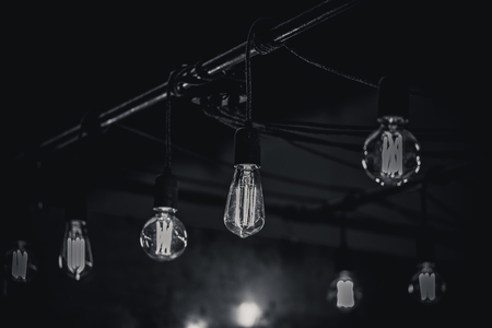 Monocrome shot of vintage light bulbs over a bar, switzerland