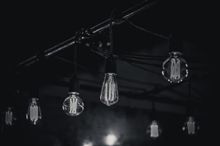 Monocrome shot of vintage light bulbs over a bar, switzerland